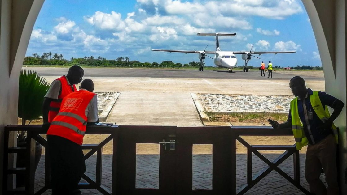 Airport in Malindi with Airplane on runaway and operators at work