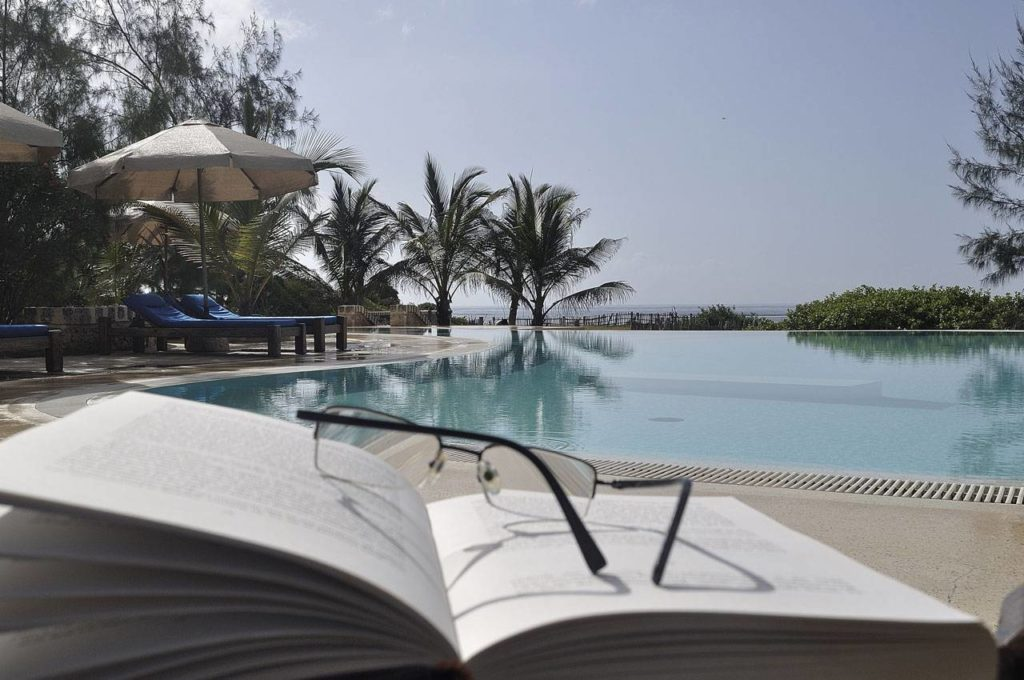 Book and glasses at Lonno Lodge Swimming Pool 1280x850