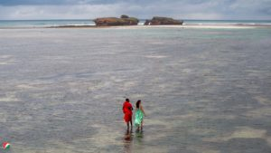 Alisha Popat with Emmanuel the Masai walking at low tide